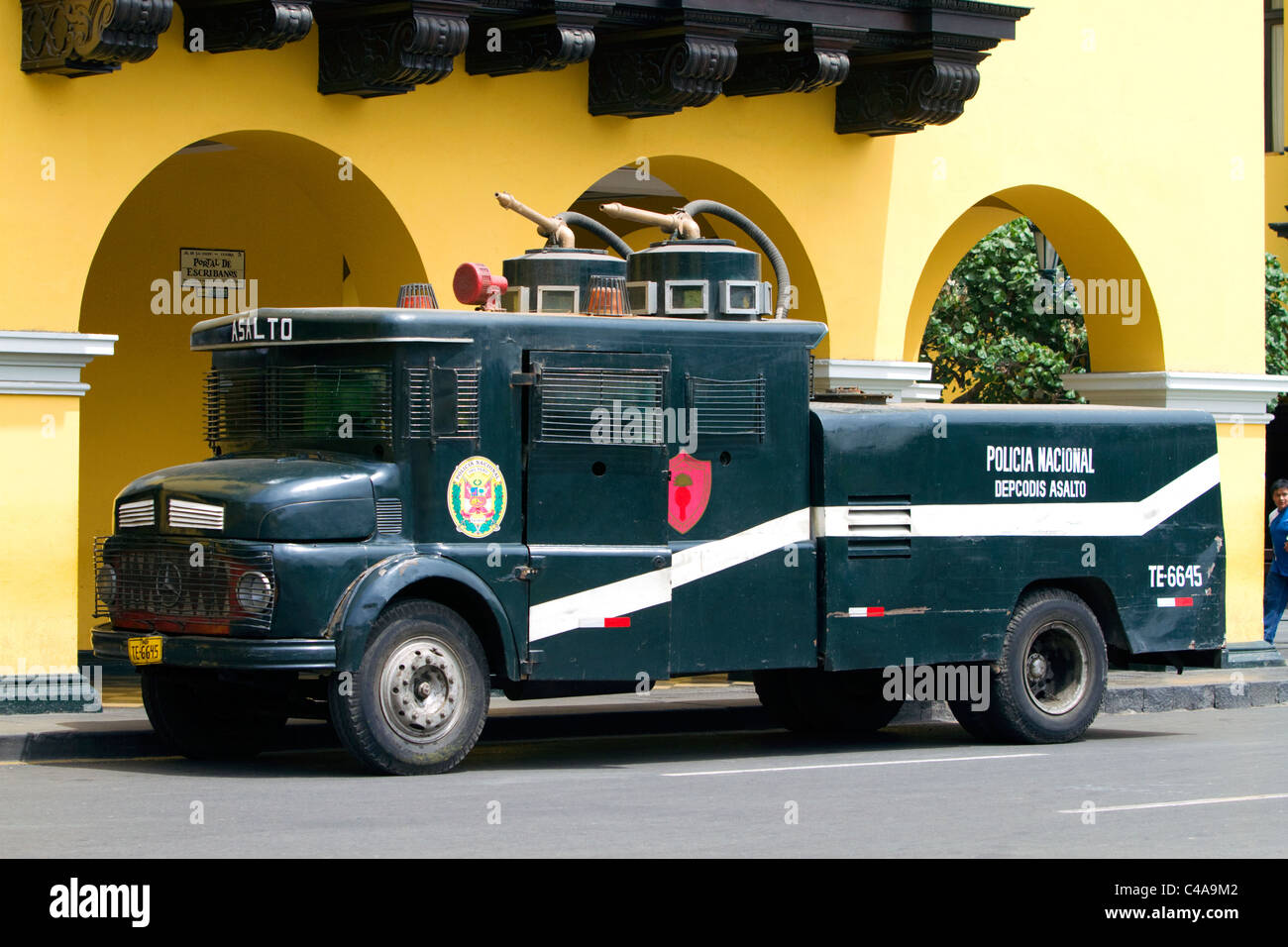 National police water cannon vehicle used for crowd control, parked at the Plaza Mayor or Plaza de Armas of Lima, - Stock Image