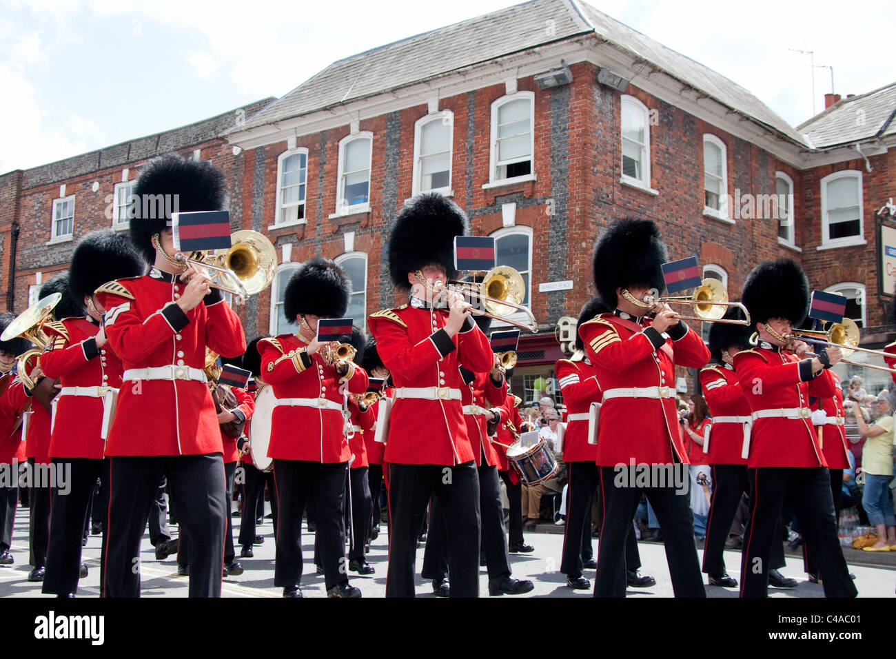 the 1st Battalion Scots Guards parade through Wantage, Oxfordshire, UK in full ceremonial dress. - Stock Image