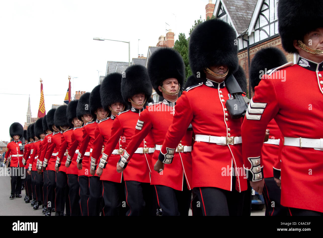 The 1st Battalion Scots Guards at the Freedom of Wantage Parade 21 May 2011. Three black soldiers in front rank. - Stock Image