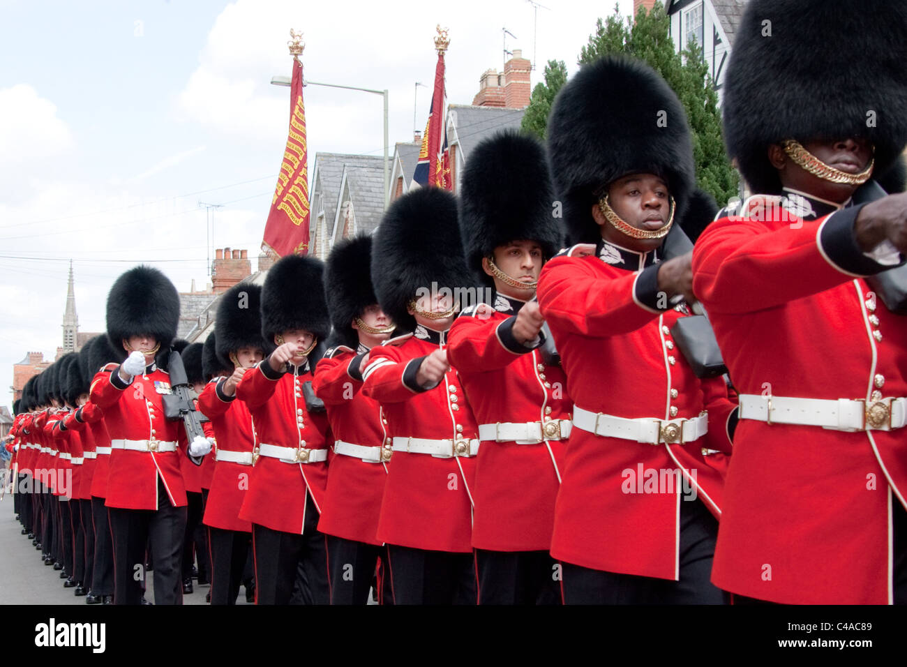 The 1st Battalion Scots Guards at the Freedom of Wantage Parade 21 May 2011. Two black soldiers in front rank. - Stock Image