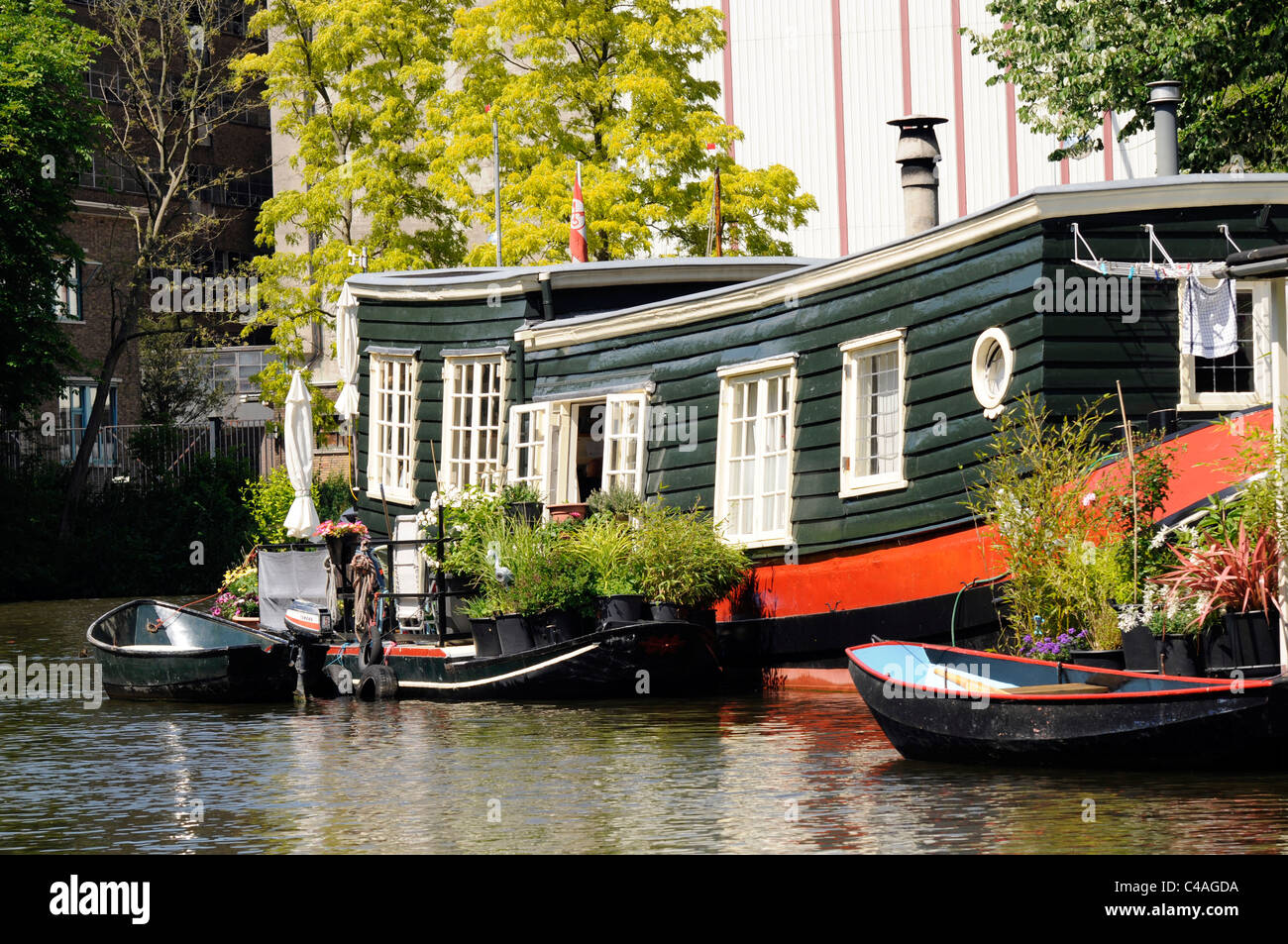 House boat on canal in Leiden, Holland - Stock Image