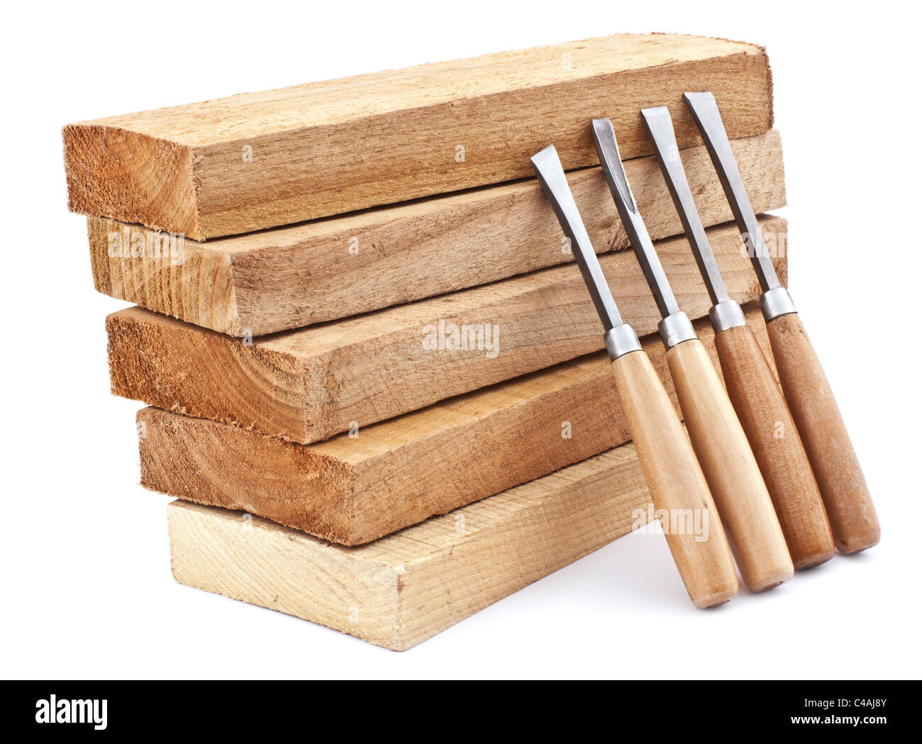 Wooden board and chisels for wood isolated on white - Stock Image
