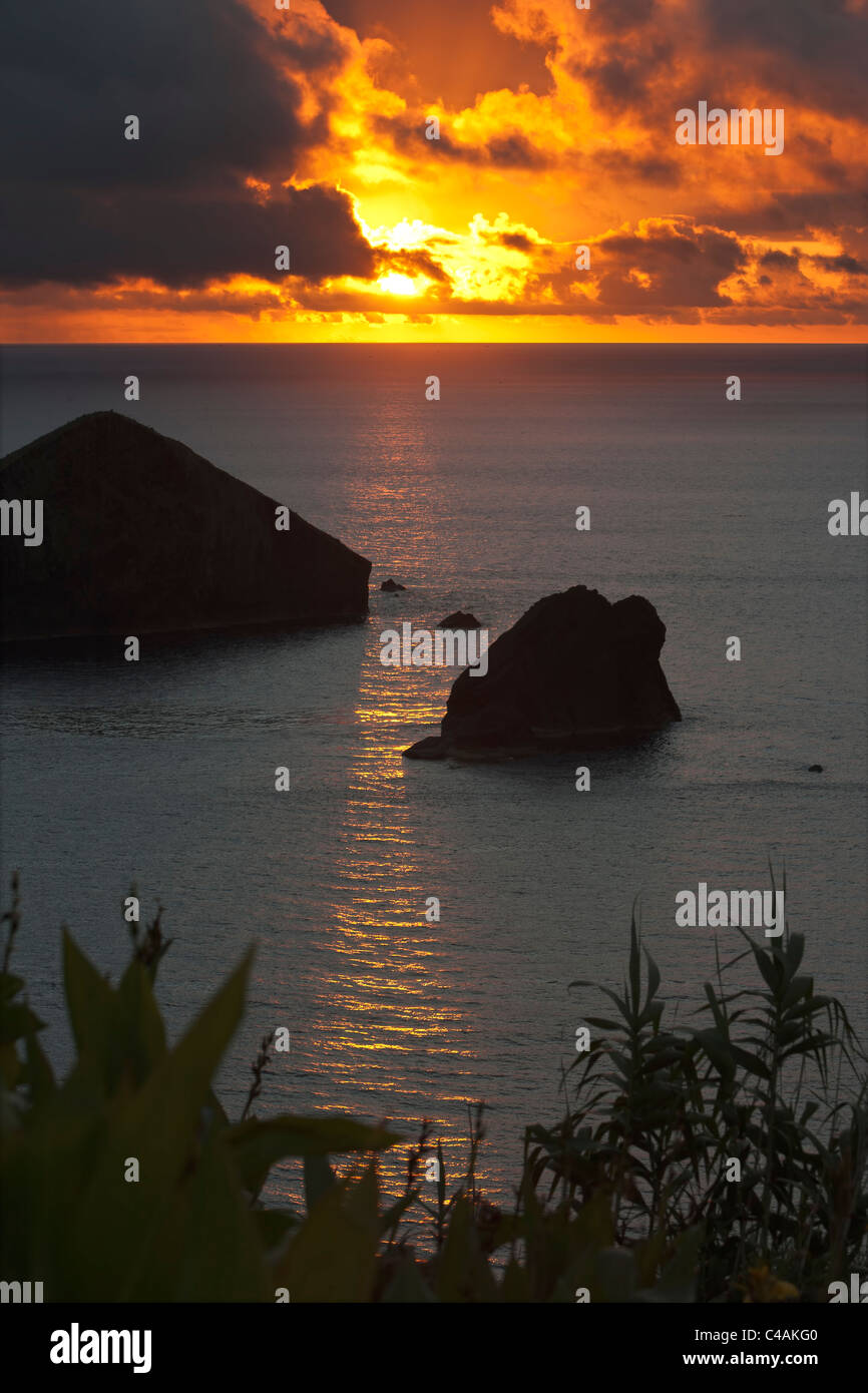 Sunset over Ilheu Mosteiros in the Azores - Stock Image