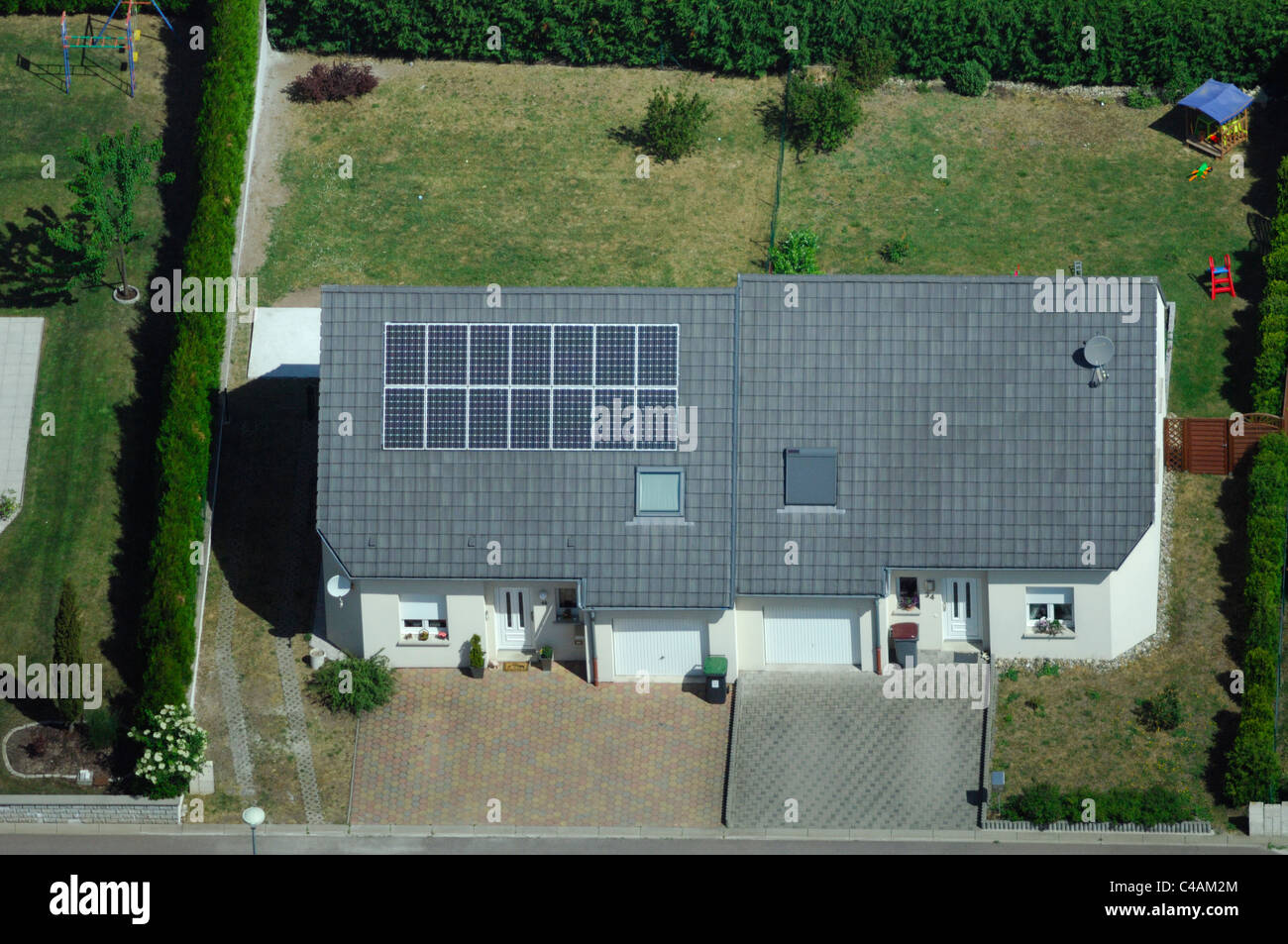 Aerial view of private house with photovoltaic panels on roof, France - Stock Image