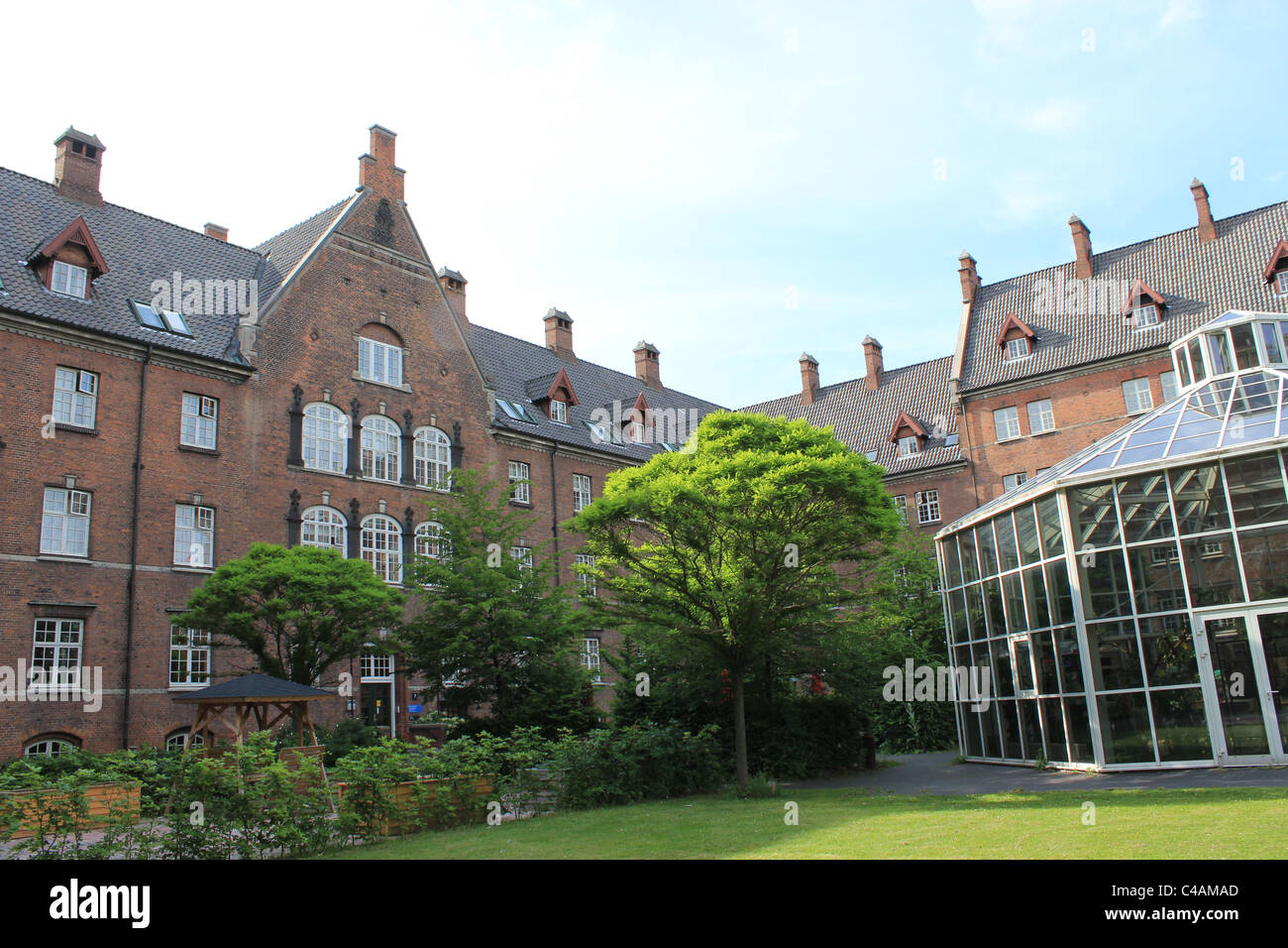 Danish old people's home which has a conservatory in the courtyard. - Stock Image