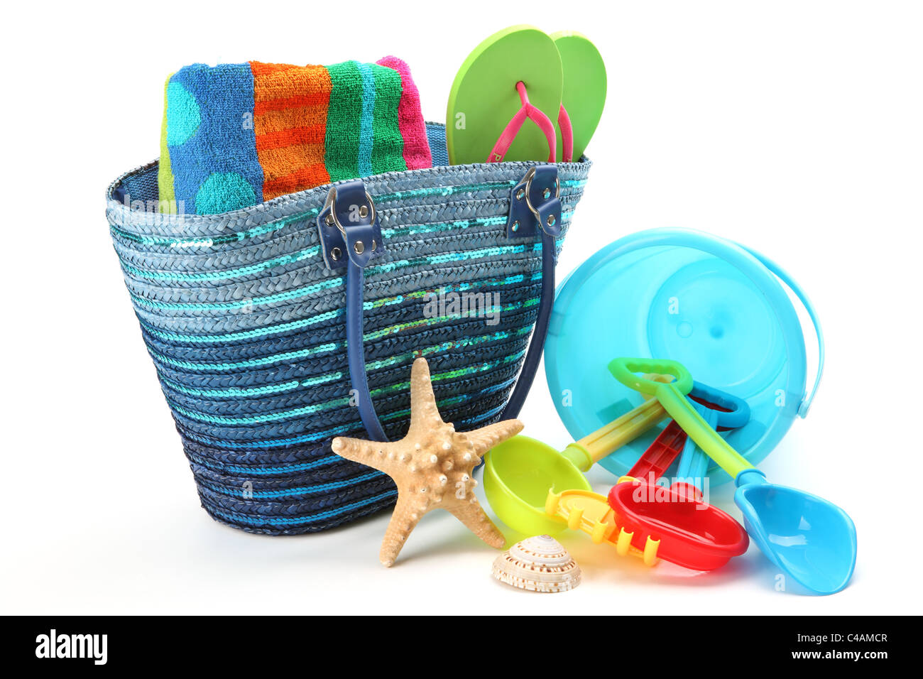 Beach bag and toys,isolated on white background. - Stock Image