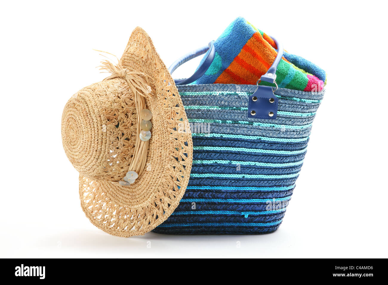 Beach bag with straw hat and towel,isolated on white background. - Stock Image