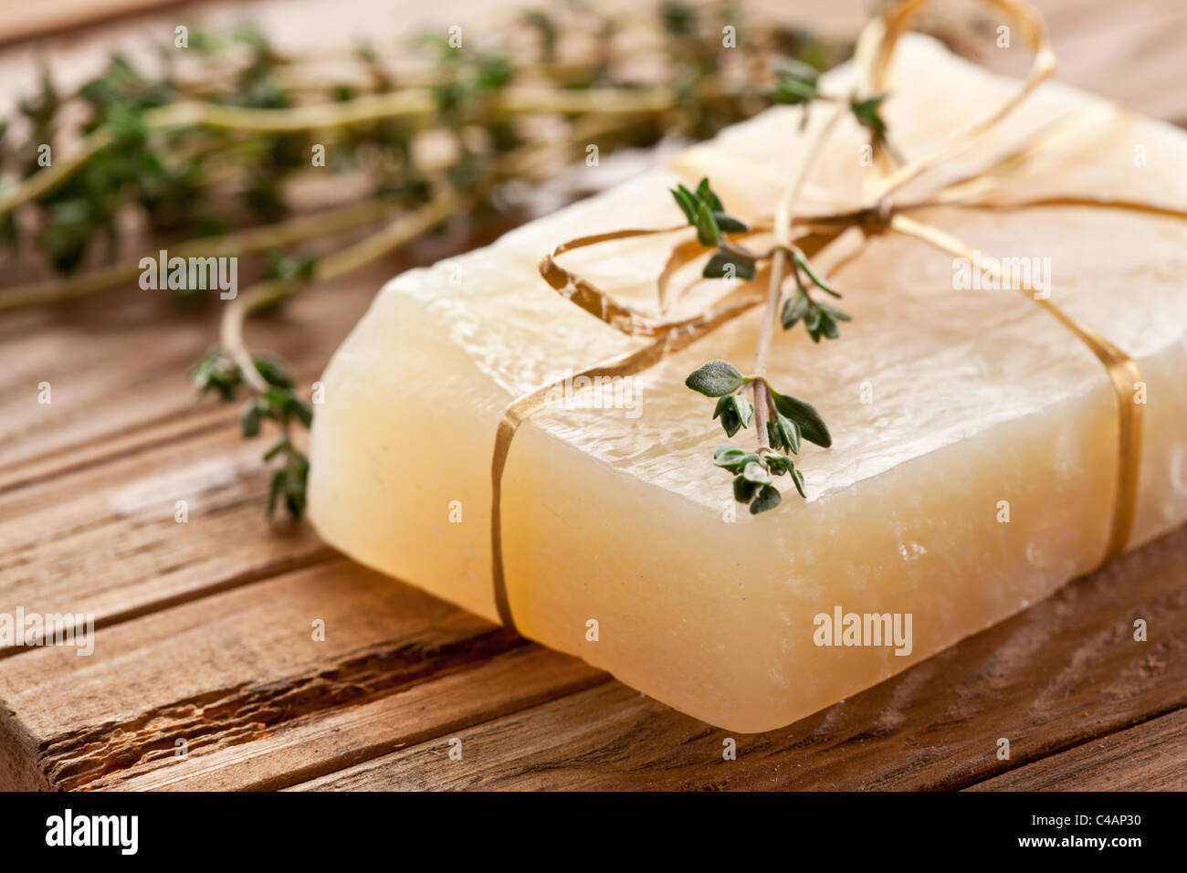 Piece of natural soap with thyme. - Stock Image