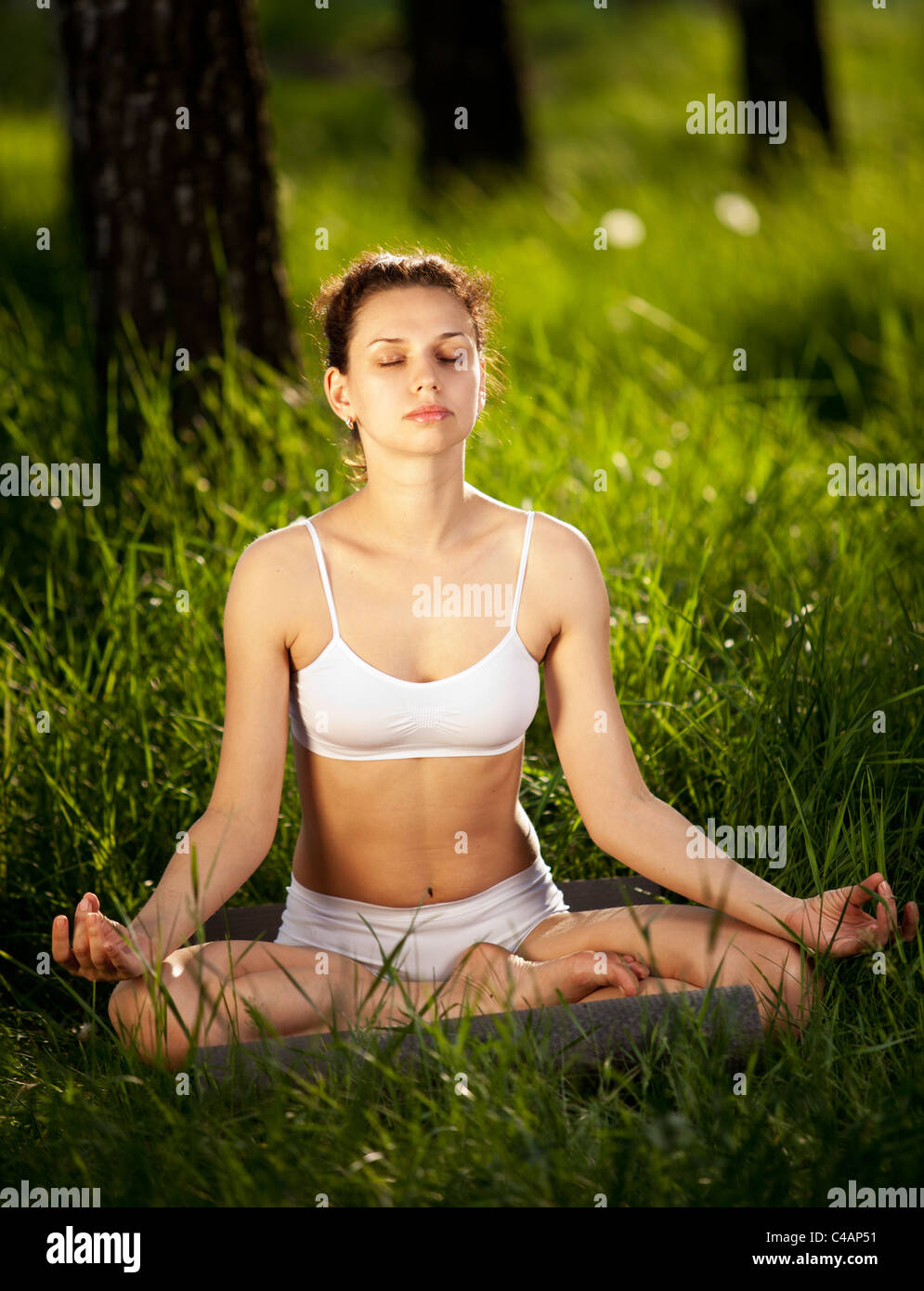 Practicing of yoga outdoors. Stock Photo