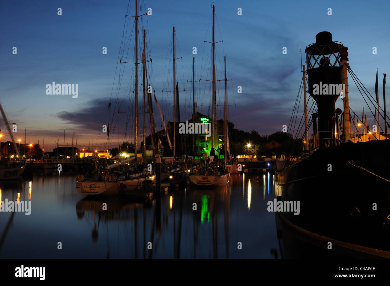 Hull Marina at dusk with the Spurn Lightship in the foreground, Yorkshire, England Stock Photo