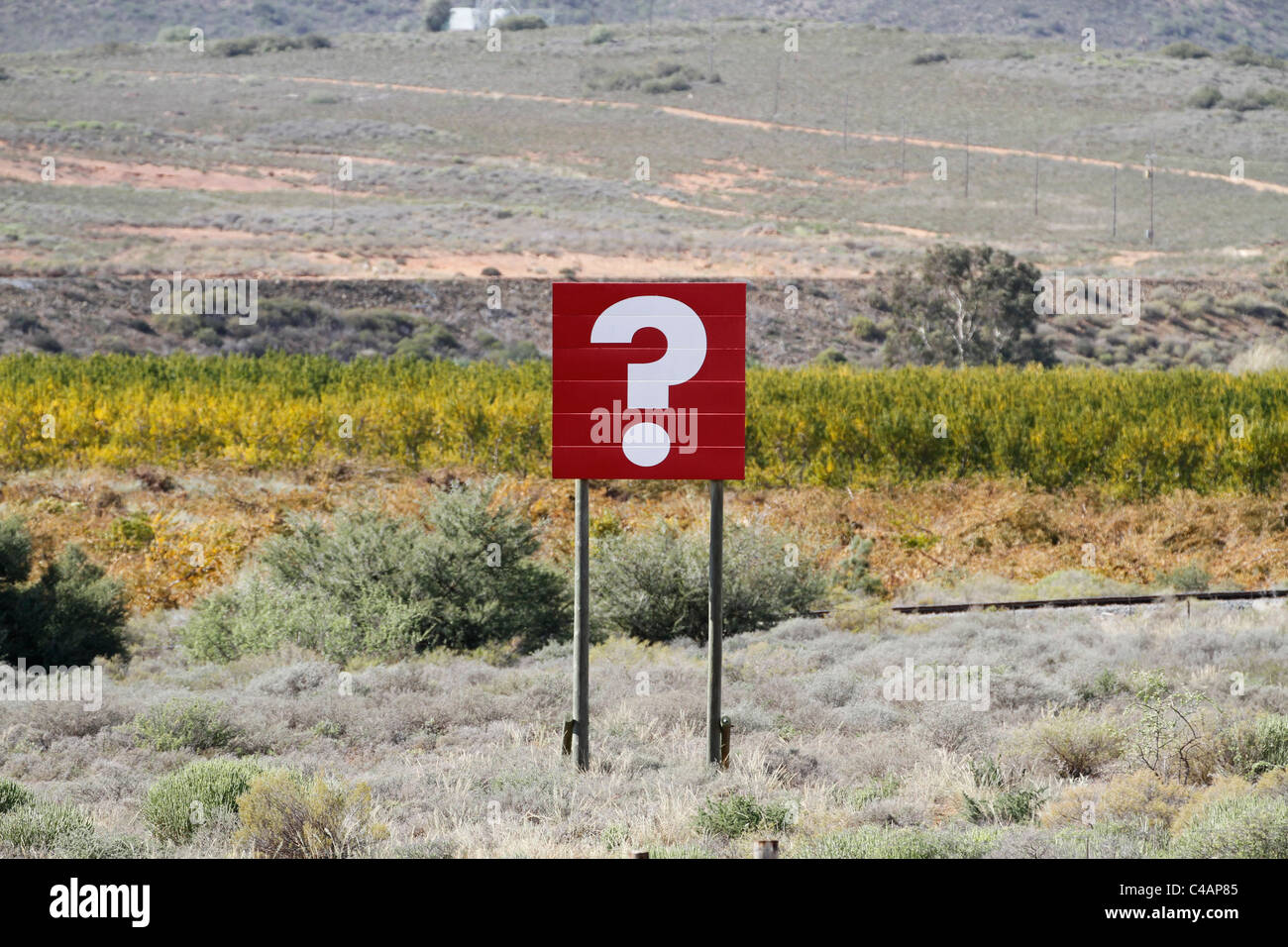 White question mark  on red billboard next to the national road in the Western Cape, South Africa. - Stock Image
