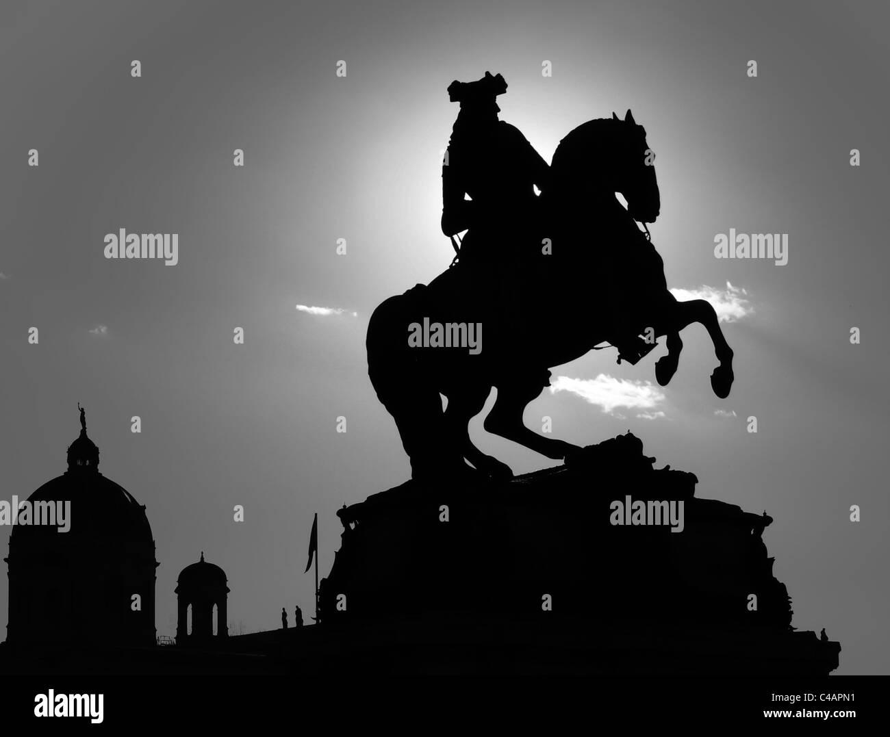 silhouette of a rider staute at vienna's heldenplatz - Stock Image