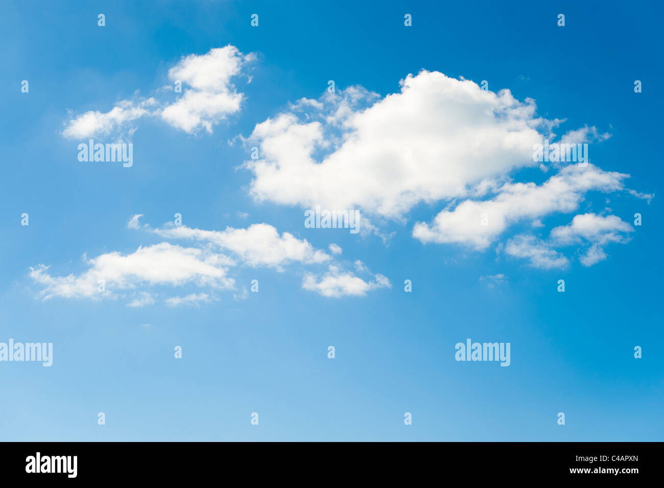 fluffy white Cumulus Humilis or Cumulus fractus clouds on a fine bright sunny day - Stock Image