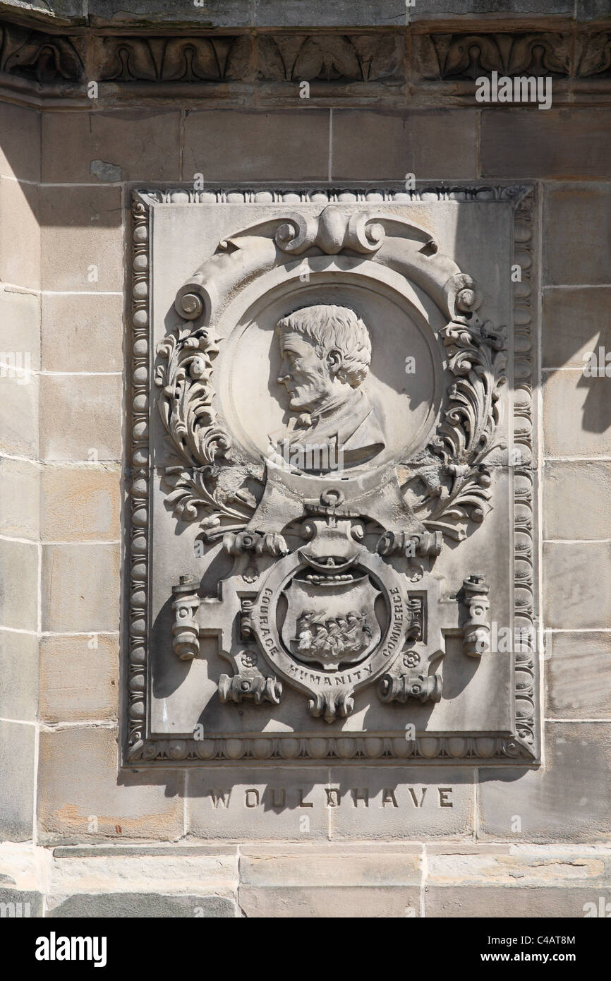 Stone relief of lifeboat inventor  William Wouldhave,   Q.  Victoria jubilee memorial, South Shields, NE England, - Stock Image