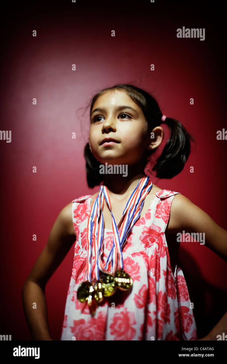 Winner. Girl with medals. - Stock Image