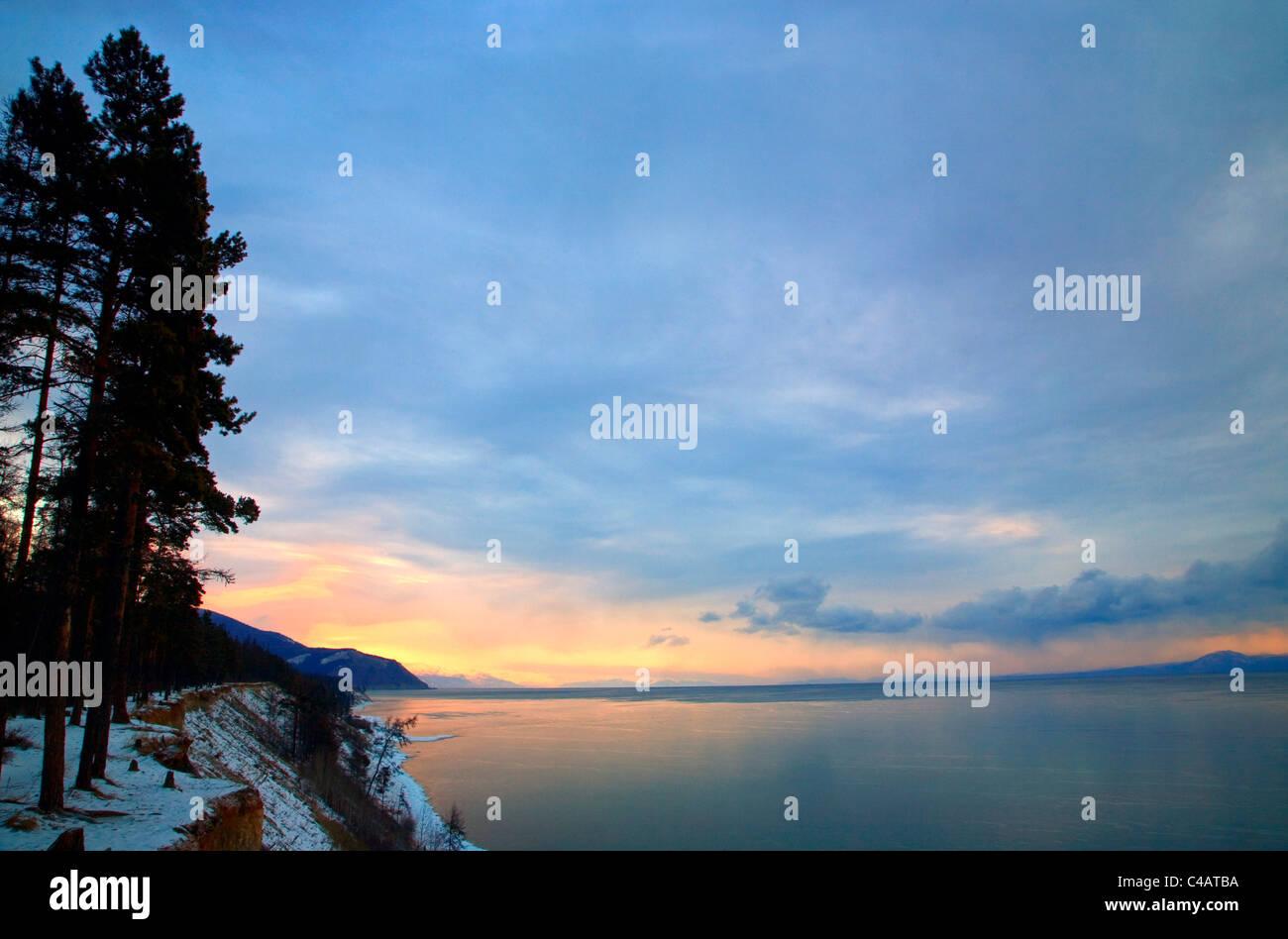 Russia, Siberia, Baikal; Morning light on Lake Bakal partly frozen in winter Stock Photo