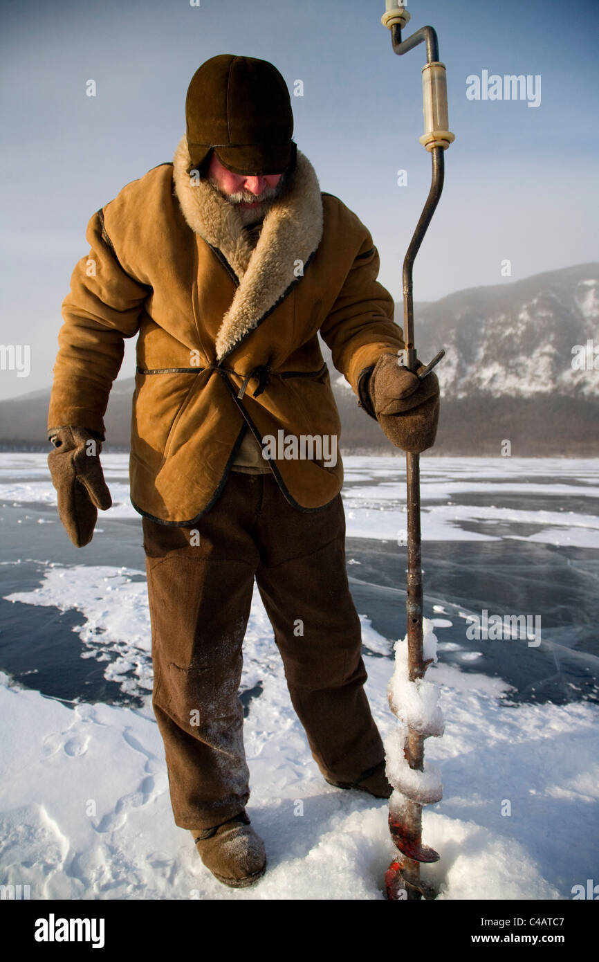 Russia, Siberia, Baikal; Undergoing preparations for fishing on frozen lake baikal in winter Stock Photo
