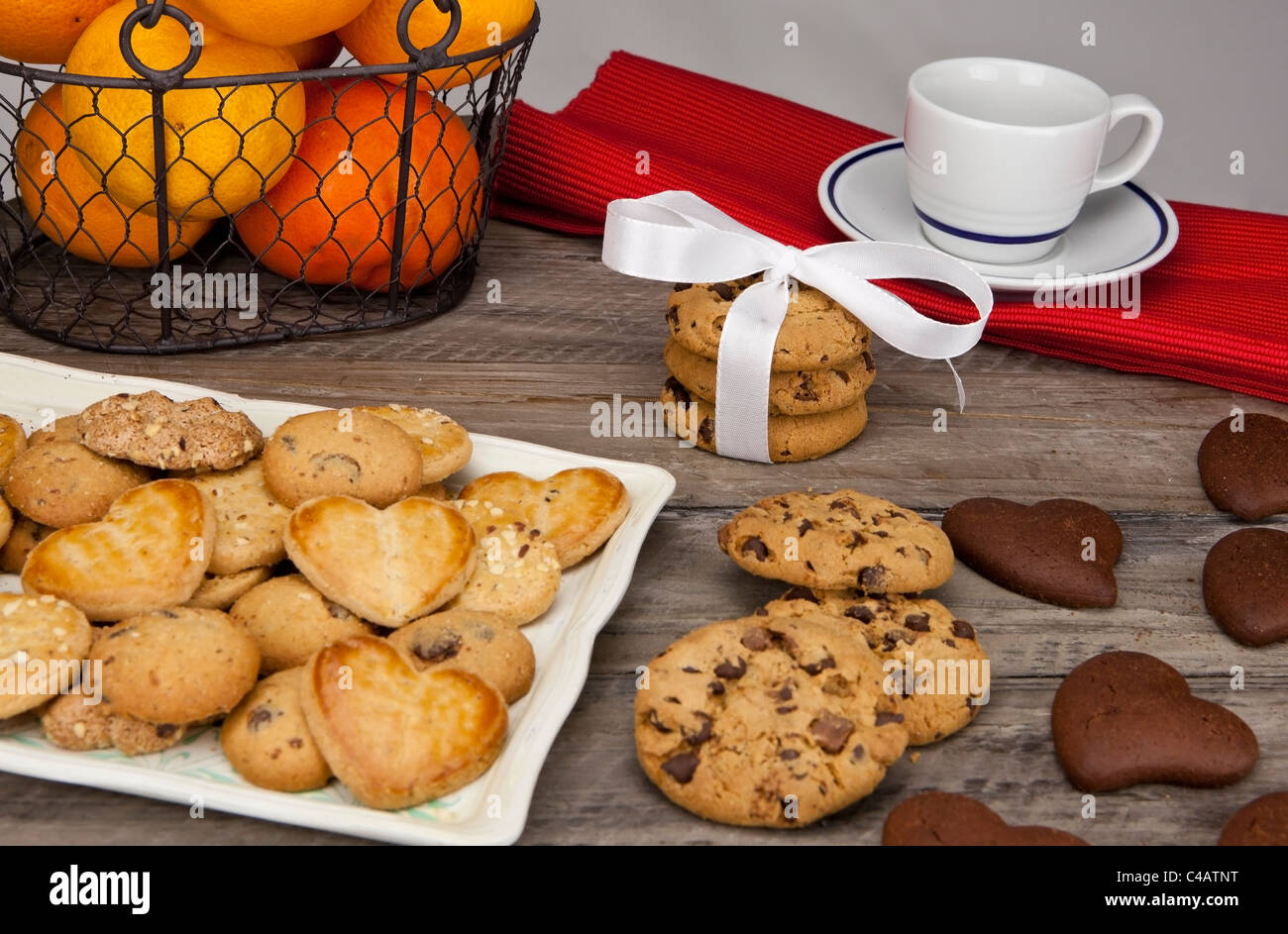 Decorated table for a snack with fruit, milk and cookies - Stock Image