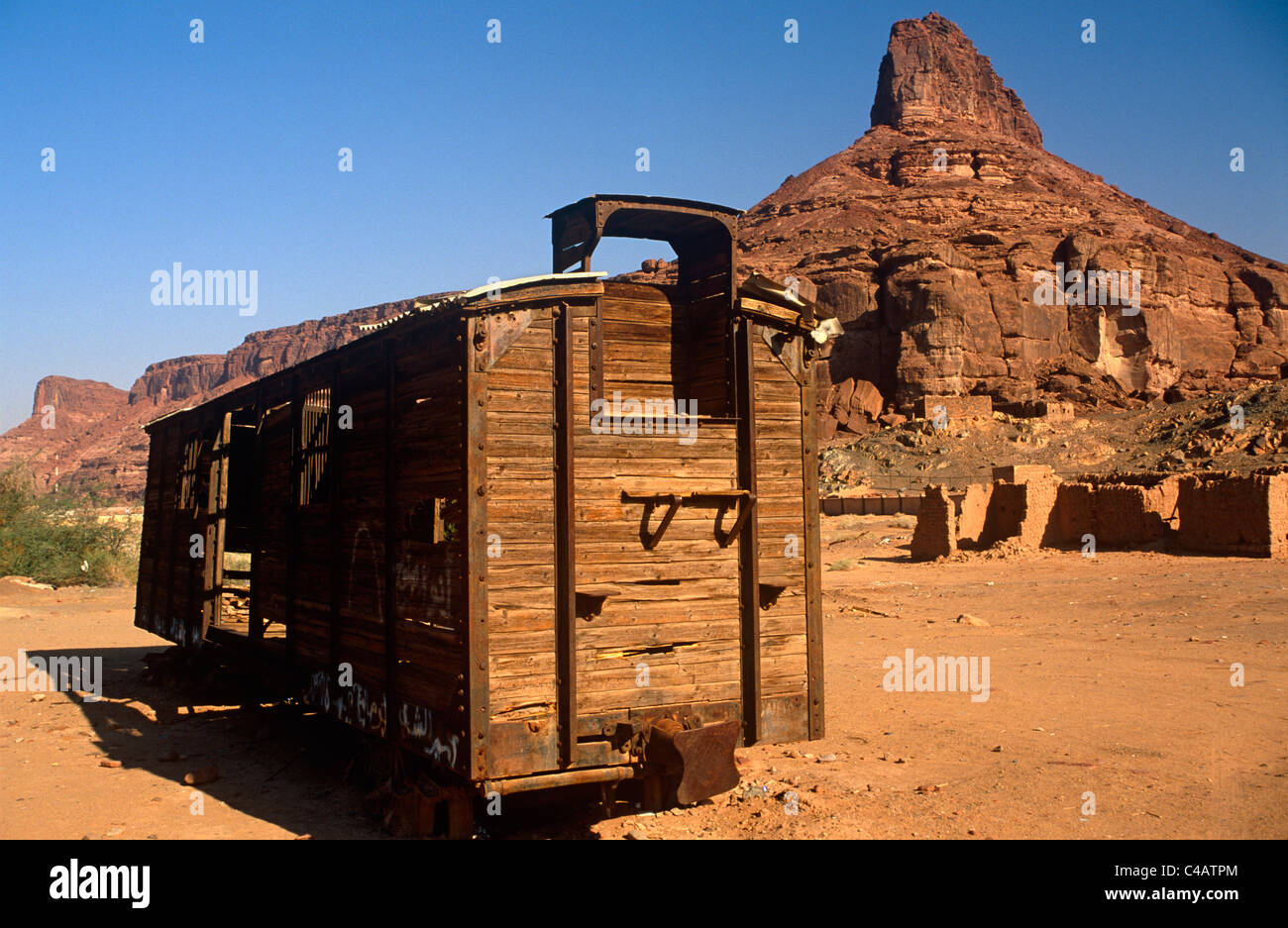 Saudi Arabia, Madinah, Al-Ula. Remnants of the famous Hejaz Railway, including this abandoned cargo wagon, - Stock Image