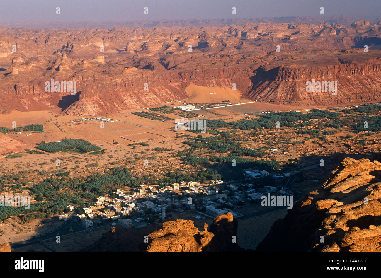 Saudi Arabia, Madinah, Al-Ula. A view of the town and oasis of Al-Ula from the surrounding hills. - Stock Image