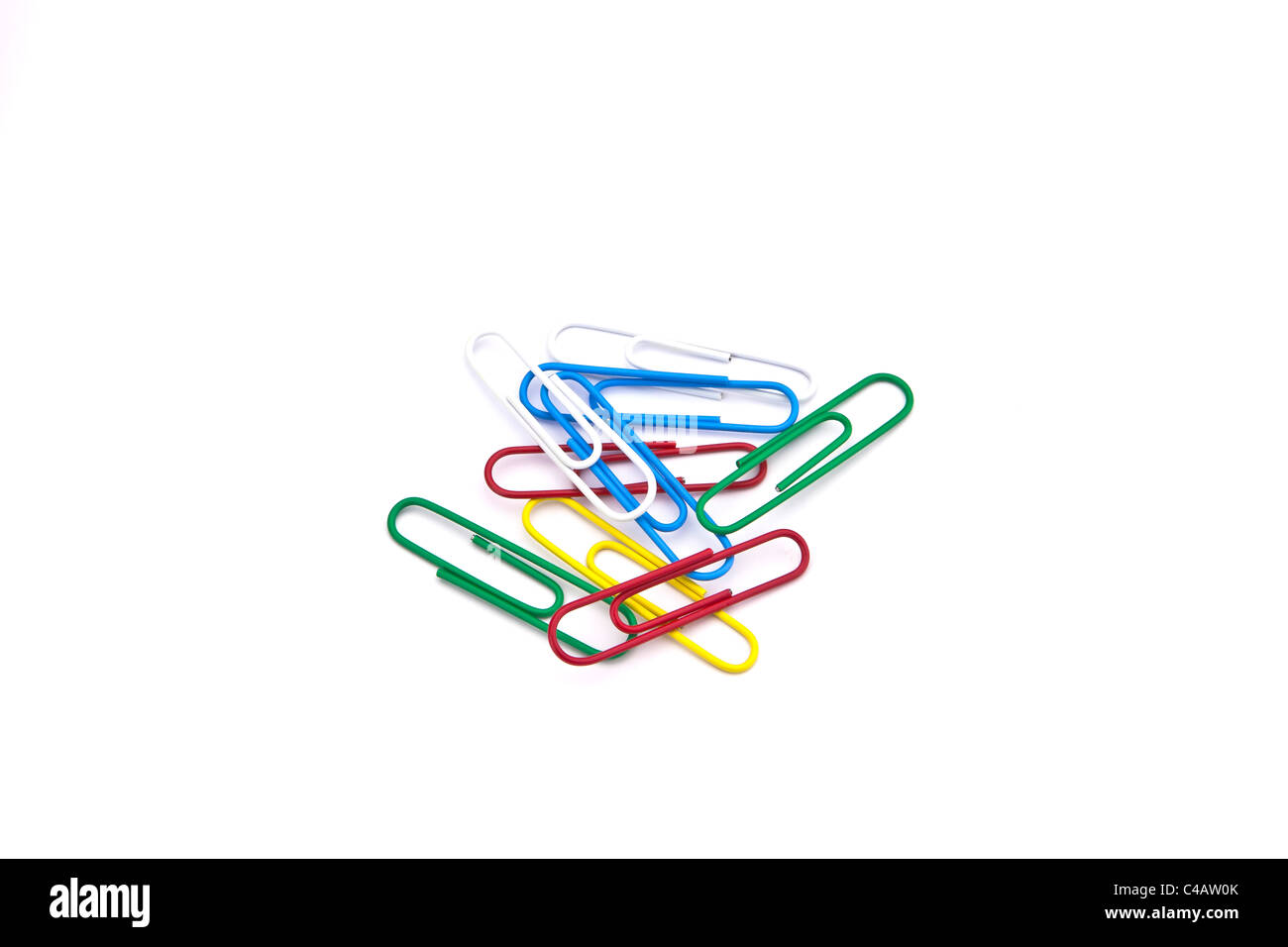 colored paper clips on white background - Stock Image