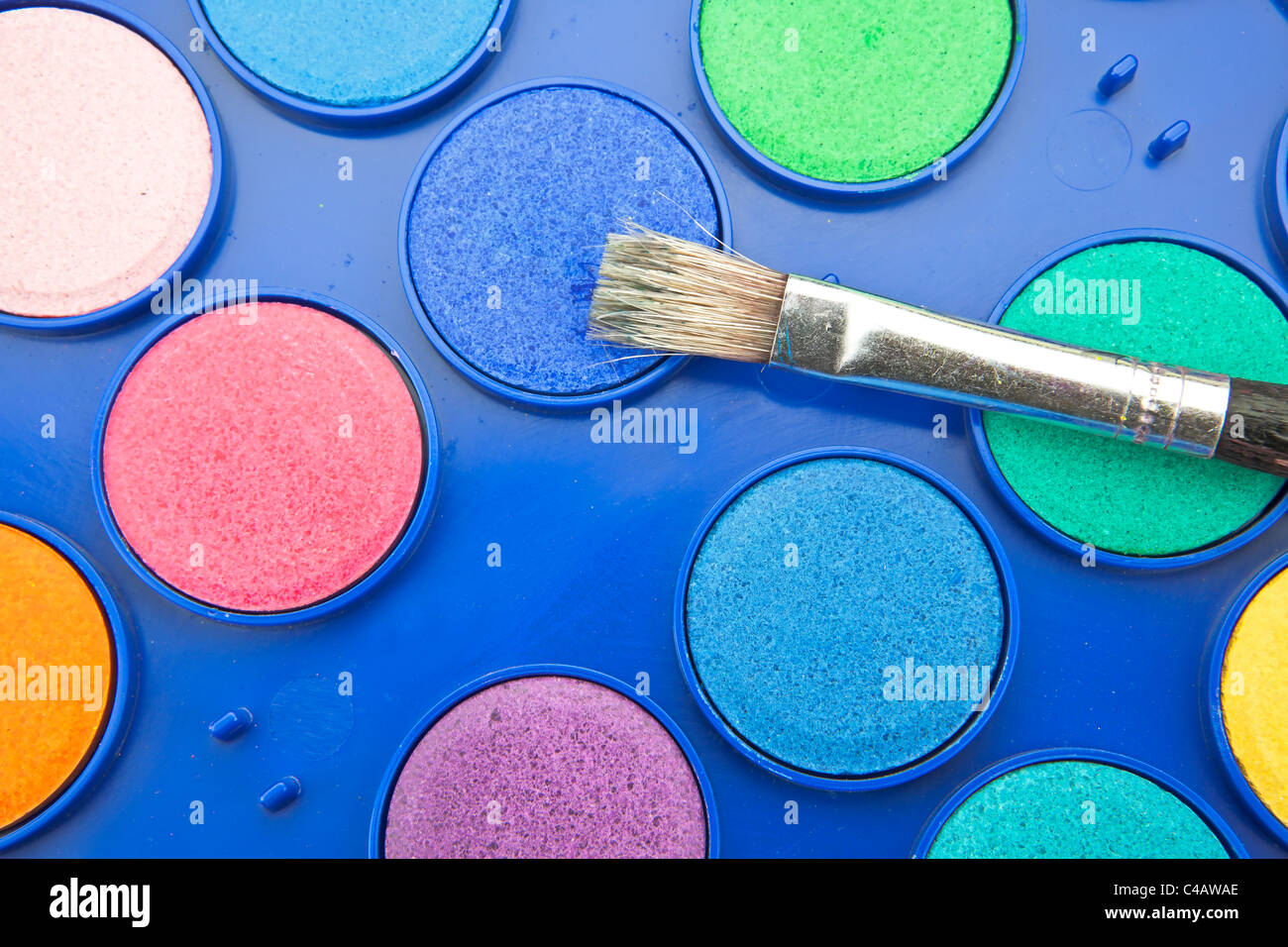 Water colors in a paint box with brush - Stock Image