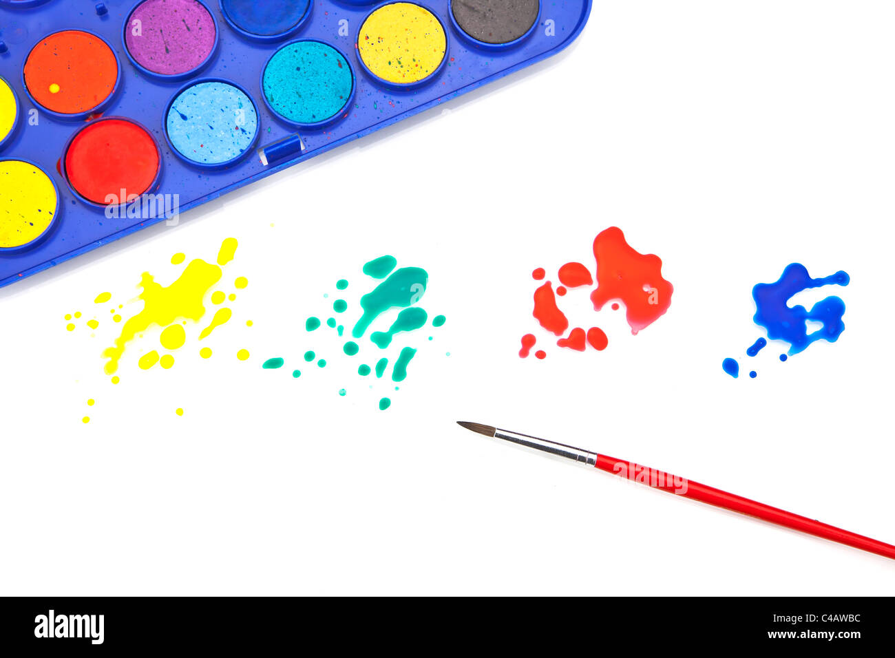 Splashes of color and a paint box with water colors and a brush - Stock Image