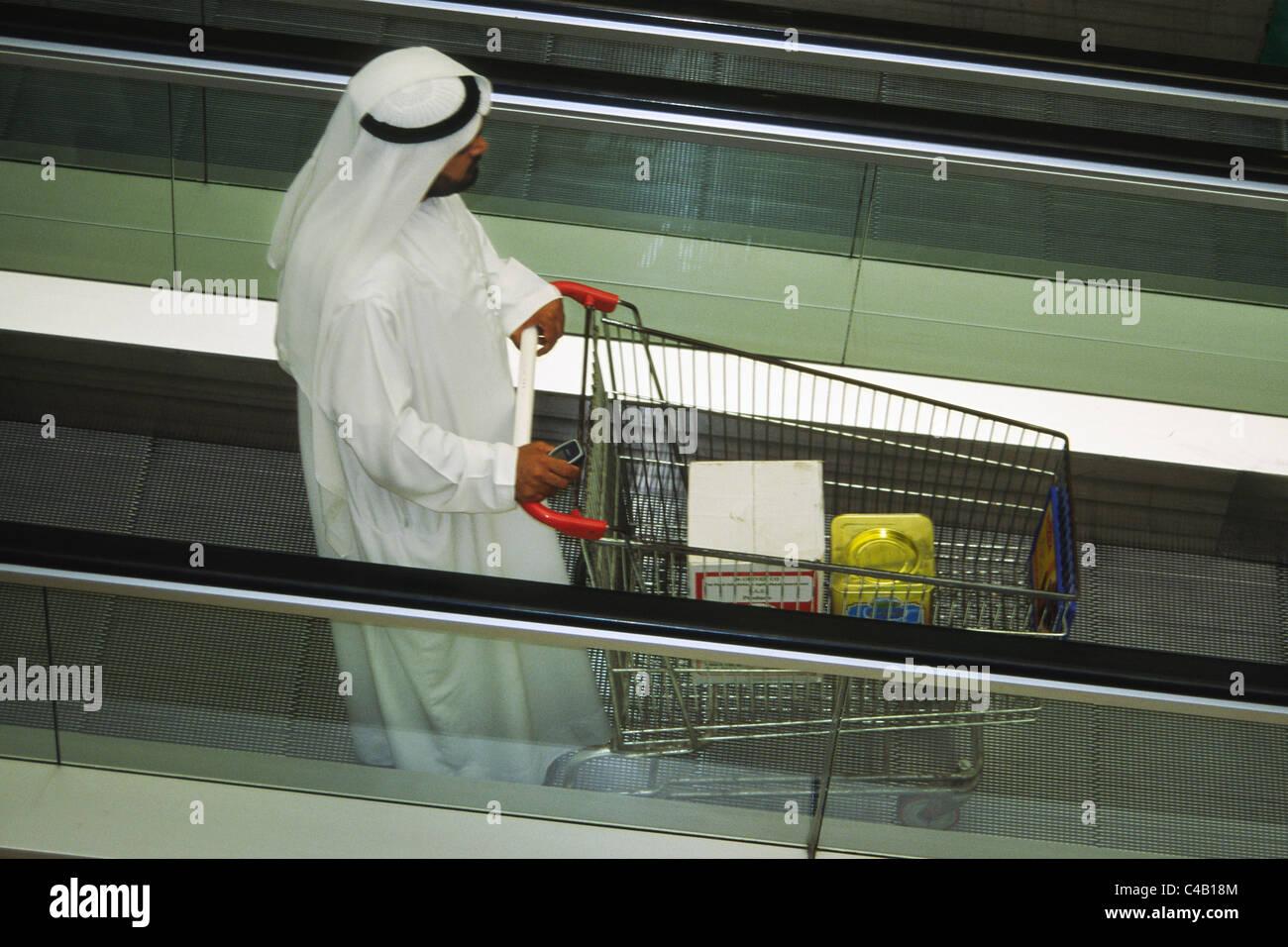 Local arab shopper in the supermarket in Dubai, United Arab Emirates. - Stock Image