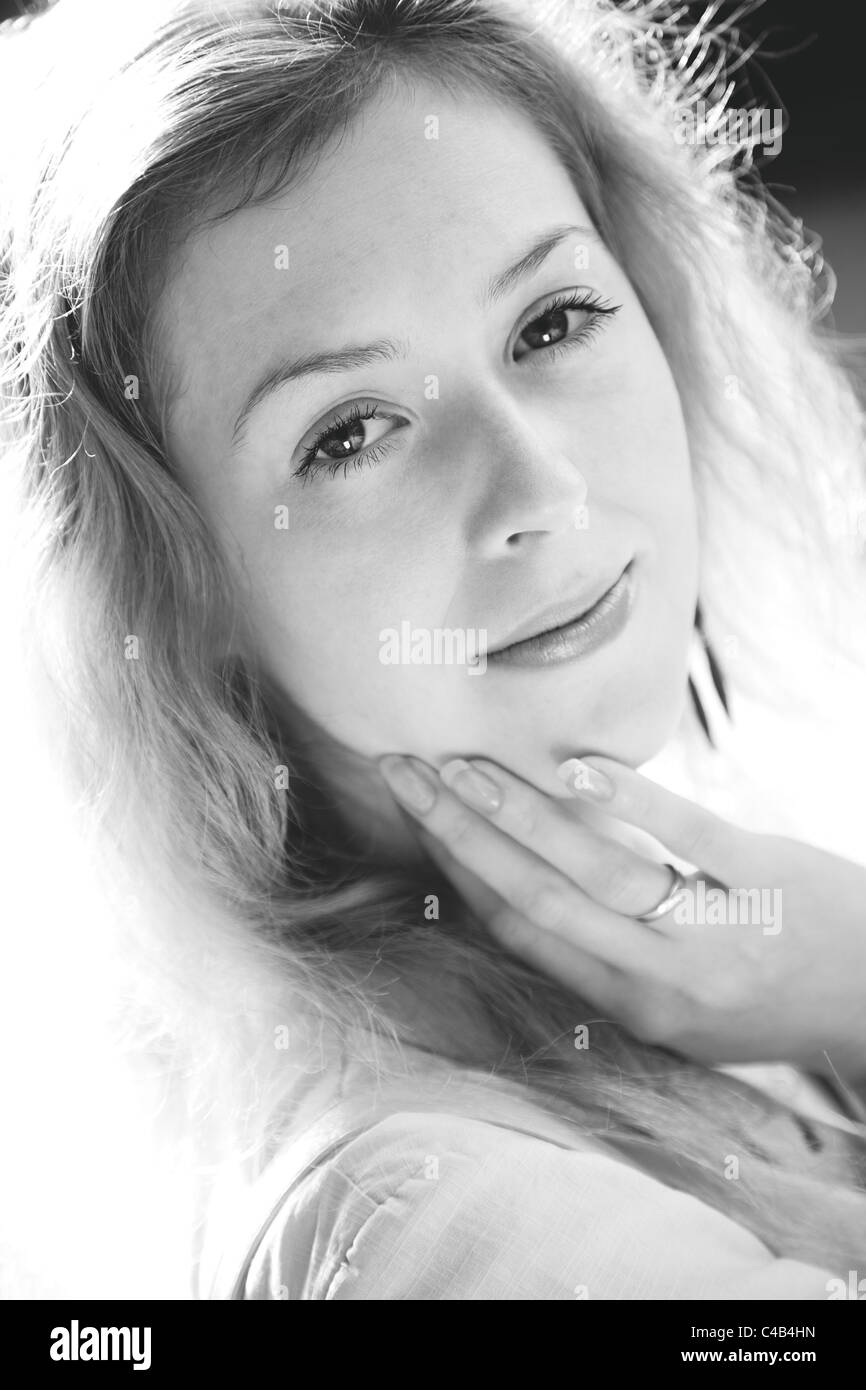Young woman outdoors portrait. Black and white colors. - Stock Image