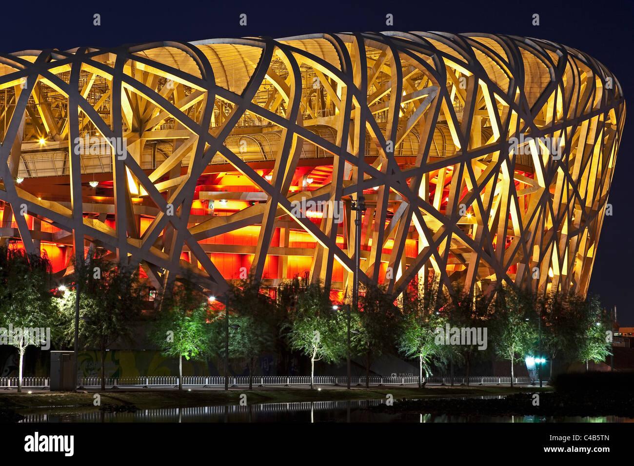 Exterior of the Olympic Stadium, Datun, Beijing, China by night - Stock Image