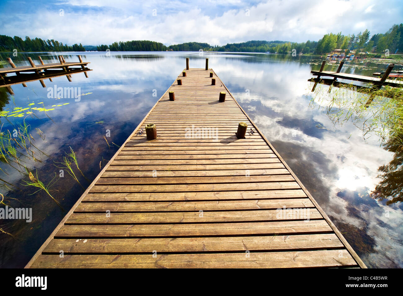 Wooden bridge. Wide angle view. - Stock Image