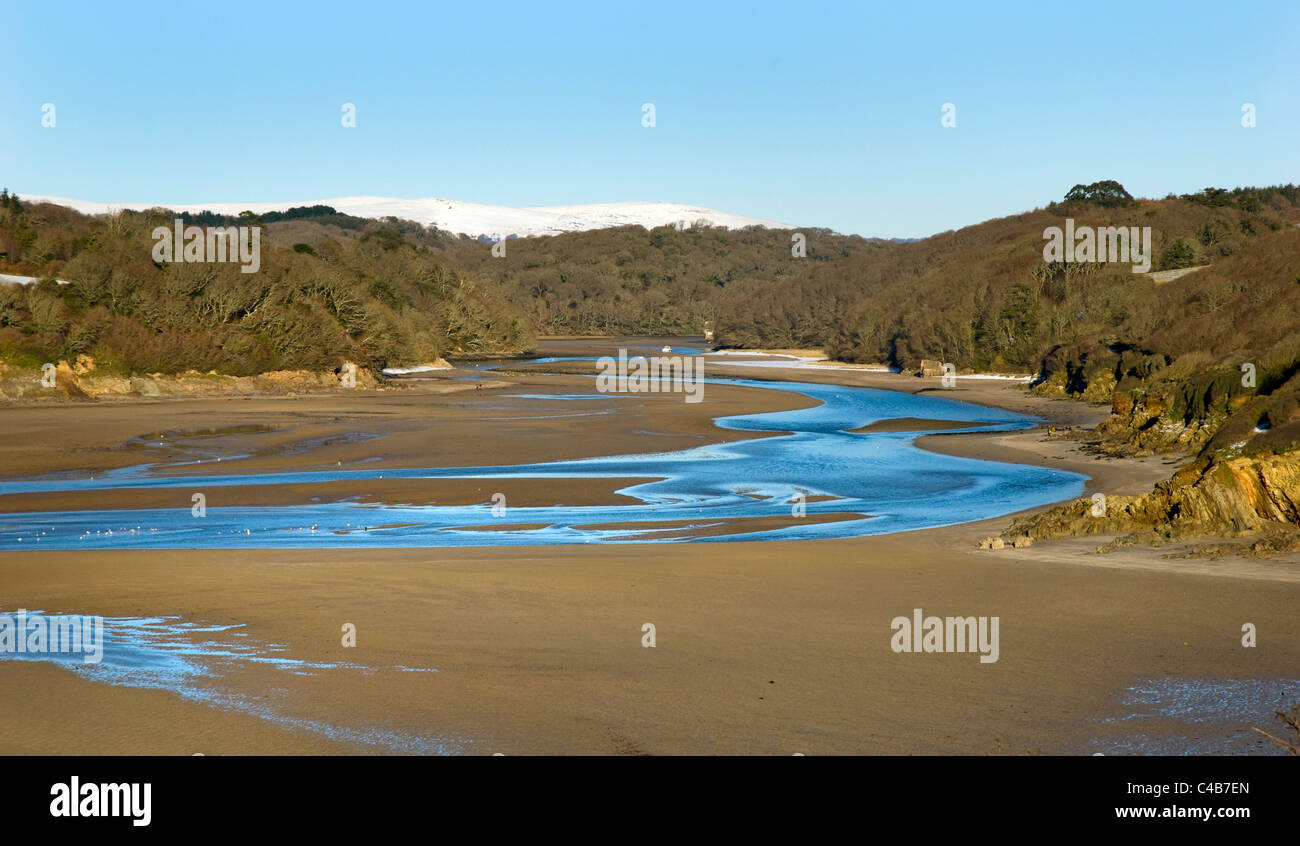 Erme estuary near kingston, snow covered dartmoor in background South hams, devon. - Stock Image