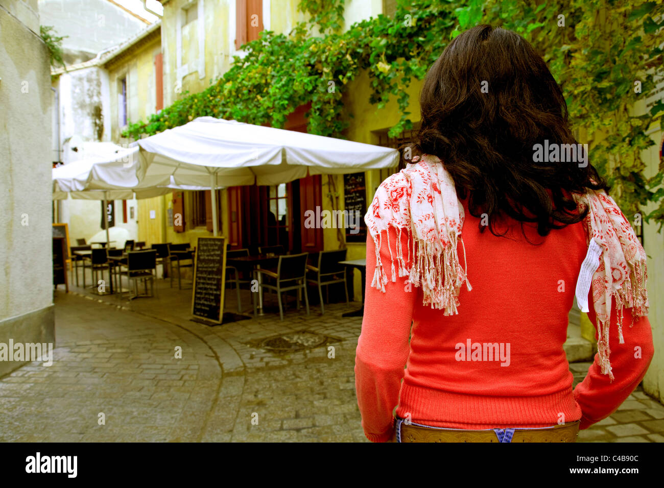 Arles; Bouches du Rhone, France; A girl standing in one of the typical streets in town. MR. Stock Photo