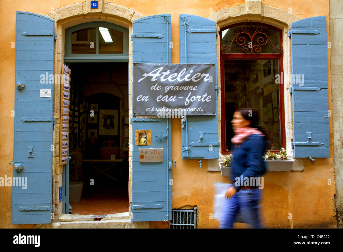 Arles; Bouches du Rhone, France; A young woman walking in front of an Atlelier's (artist's studio). MR. Stock Photo