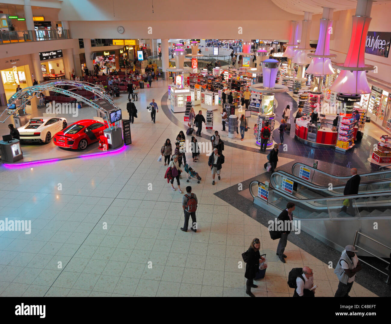 Gatwick Airport duty free shopping arcade. - Stock Image