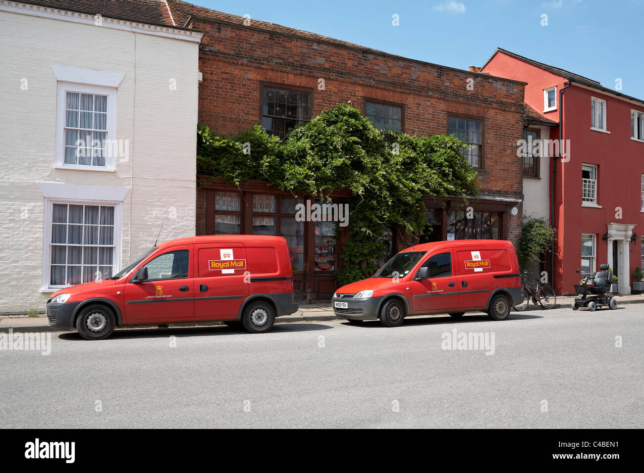 Great Britain Essex Nayland Village Post Office with Royal Mail Red Vans parked outside - Stock Image