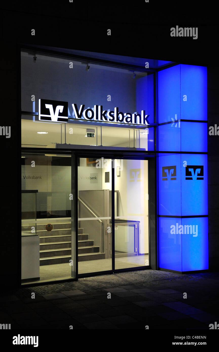 entrance door of bank at night in city regensburg in germany - Stock Image