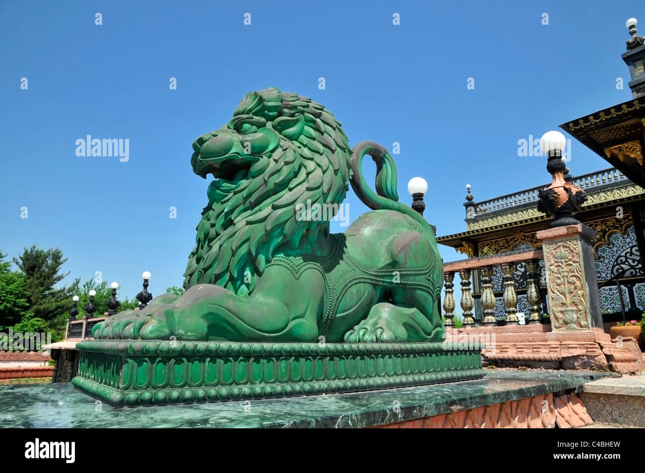Green statue of lion in front of the Palace of Gold, New Vrindaban , West Virginia,USA - Stock Image