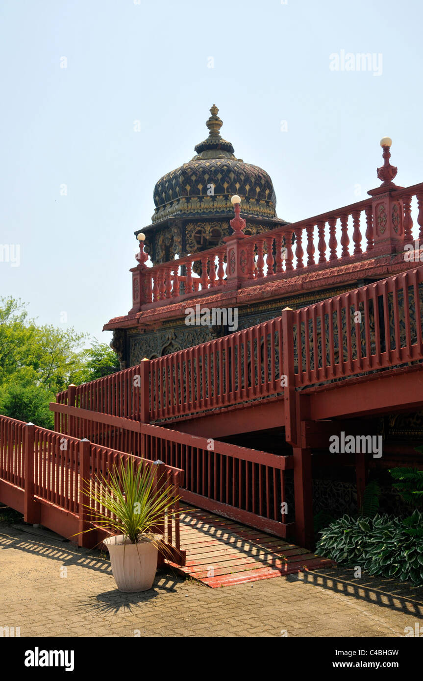 Summerhouse with red fences in front, the Palace of Gold, New Vrindaban , West Virginia,USA - Stock Image