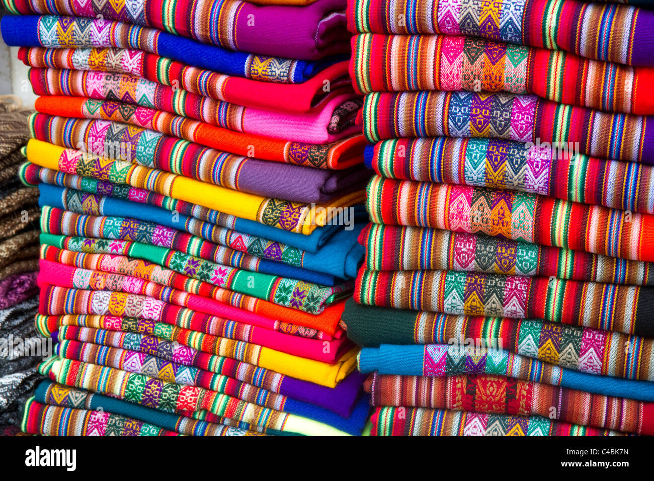 Textiles being sold at a market in Lima, Peru. - Stock Image