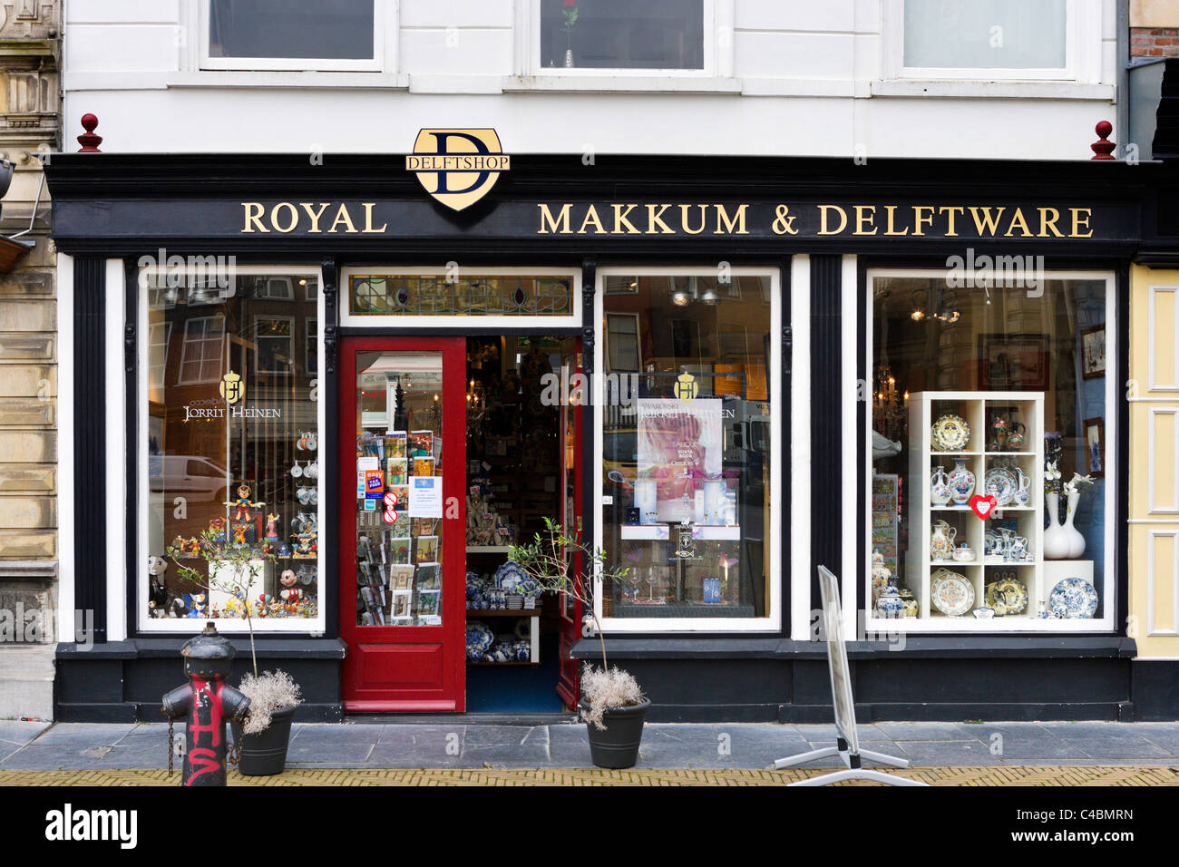 Shop selling Delft pottery in the Markt (Main Square), Delft, Netherlands - Stock Image