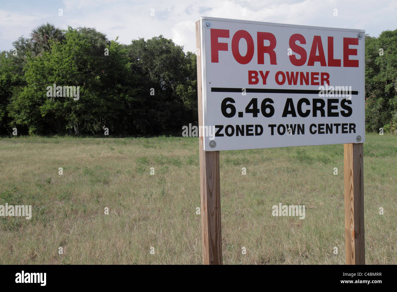 Orlando florida winter springs land for sale sign by owner zoned town center field trees