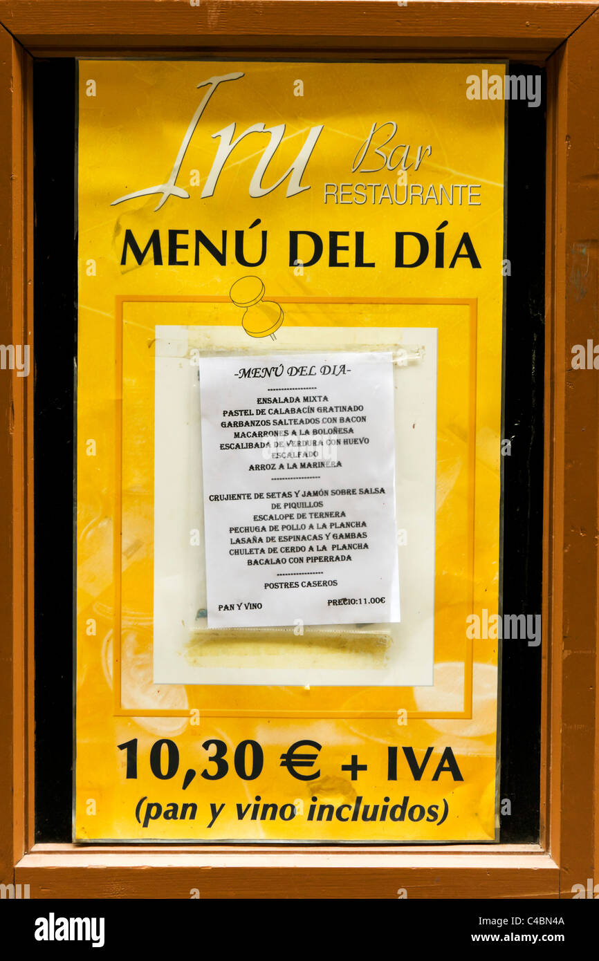 Menu outside a restaurant in the historic Old Town (Casco Viejo), Pamplona, Navarre, Spain - Stock Image