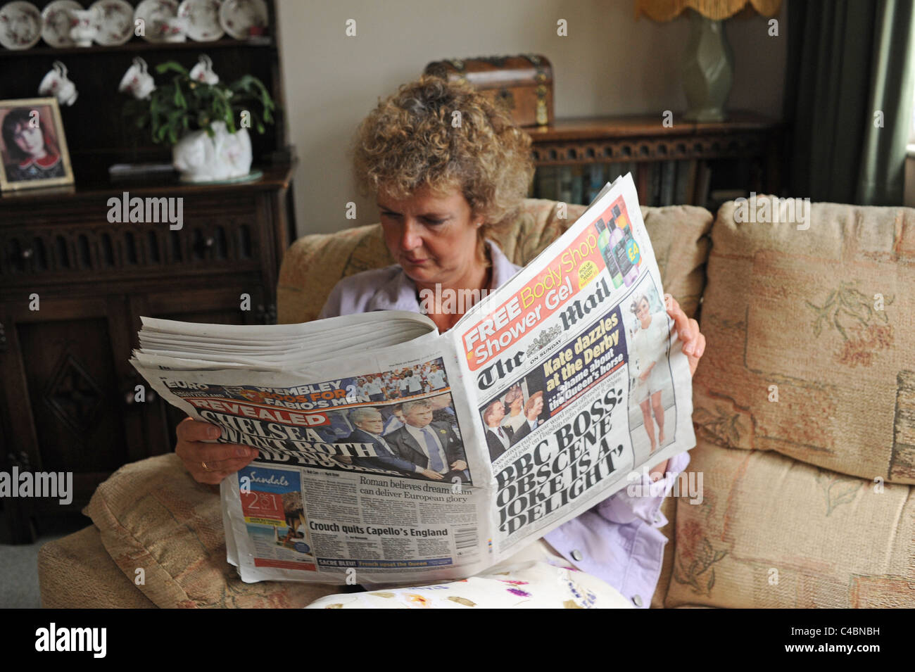 middle aged woman reading the mail on sunday british national stock