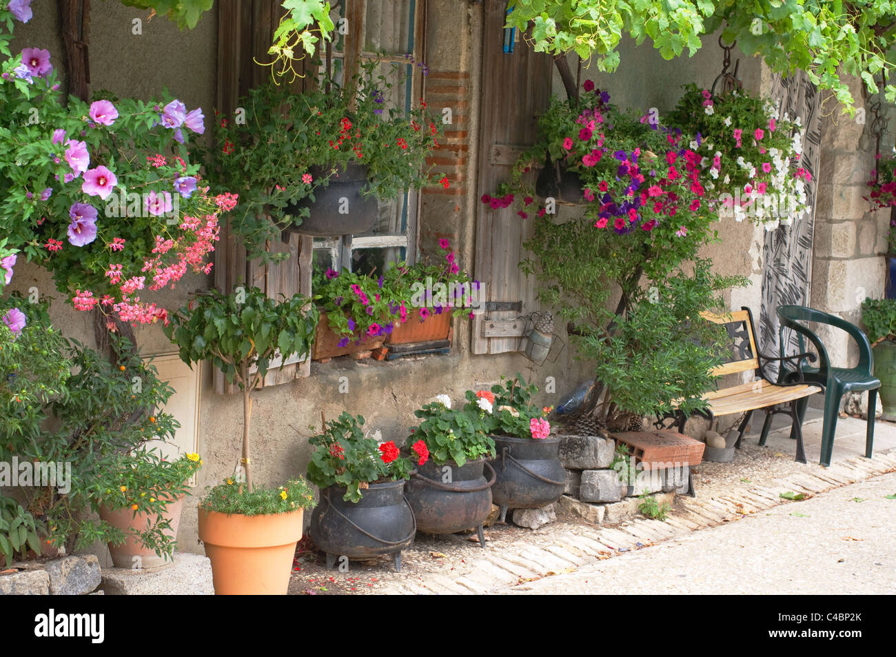 Cottage Garden Pots A french cottage with lots of hanging baskets plants and flower a french cottage with lots of hanging baskets plants and flower pots workwithnaturefo