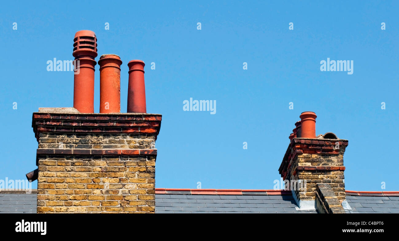 Chimney stacks on the roof of a Victorian terrace house - Stock Image