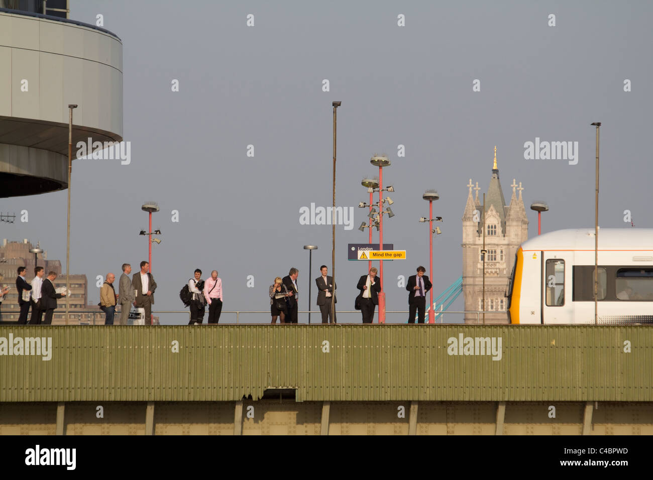 london commuters on Cannon Street station Railway Bridge originally named Alexandra Bridge, with tower bridge in - Stock Image