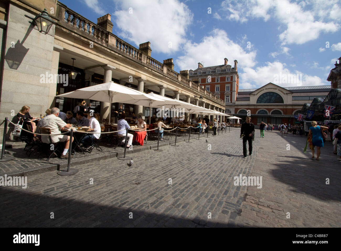 Covent garden london with diners sitting outside cafe alfresco - Stock Image