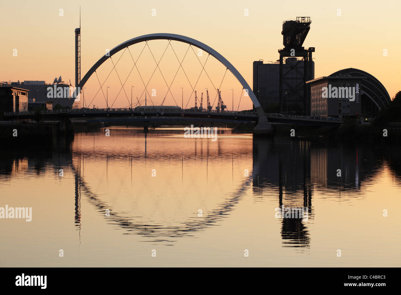 Looking West along the River Clyde towards the Clyde Arc Bridge at sunset, Glasgow, Scotland, UK - Stock Image