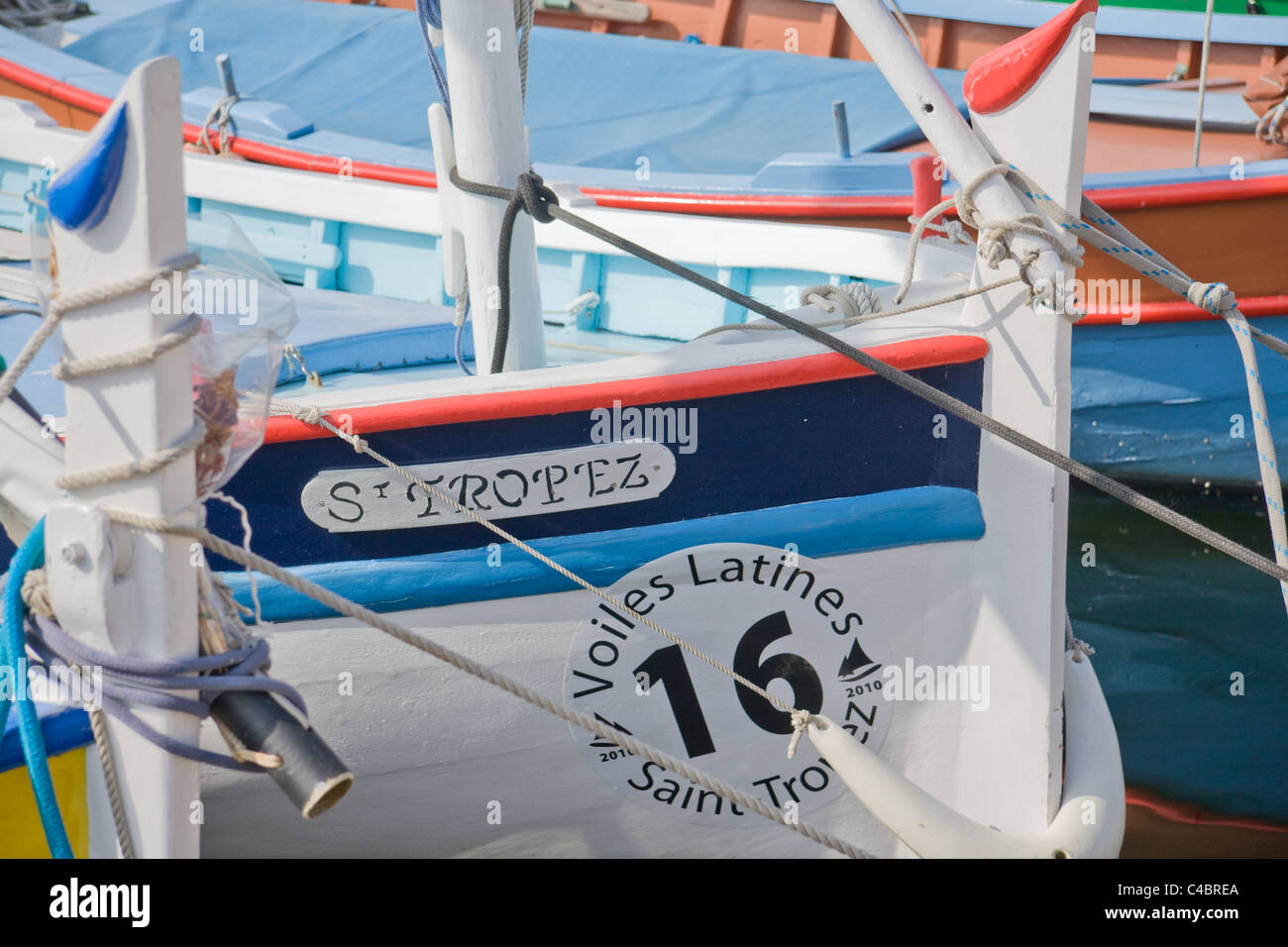 "A boat named ""St. Tropez"" is situated in the port of Saint-Tropez at the Cote d'Azur/ Provence, France Stock Photo"